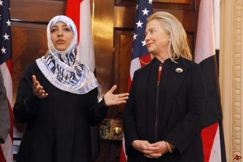 US Secretary of State Hillary Clinton (R) listens to Yemeni Nobel Peace Prize winner Tawakkul Karman speak to the press following talks at the State Department in Washington,DC on October 28, 2011